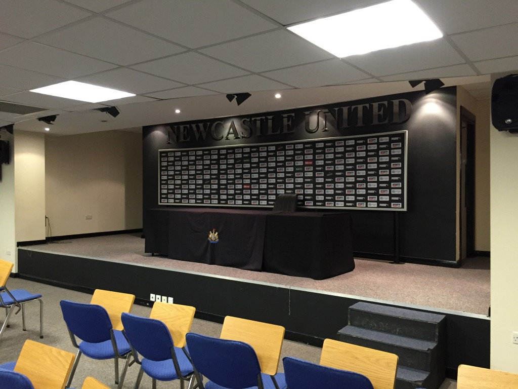 The press conference room.